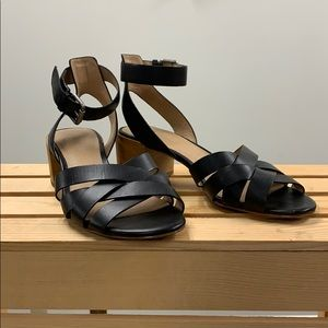 Black strappy heeled sandals